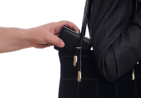 stock-photo-15966608-stealing-purse-from-the-bag